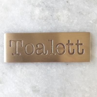 skylt toalett Exmez